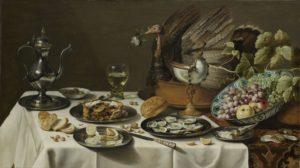 Rijkgedekte tafel 17e eeuw, stilleven met kalkoenpastei, oesters, fruit, schelp en wijn.